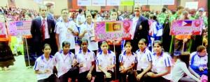 The Sri Lanka women's team - Bronze Medal winners at the 28th King's Cup World Sepak Takraw Championships. Standing (L to R) T. Zahiran Hajireen (ISTAF Referee and Coach), G. Jayatissa (Asst. Coach), Mrs. S.N. Zara (Lady Chaperone), a Thai Hostess, Nizam Hajireen (Vice President ISTAF). Squatting (L to R): Anusha Sandamali (Capt), Tharushi Herath, Sashini Samarasinghe, Kelani Palpita, Ishara Madumali, Haruni Rusmilla and Wansala Maduwanthi.