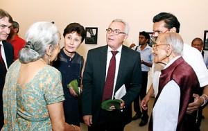 French Ambassador in Sri Lanka Jean-Paul Monchau and Madame Monchau walk around the exhibition.