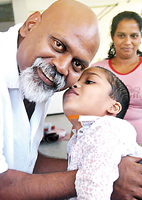 Ganesh Velautham with a young patient. Pix by Nilan Maligaspe