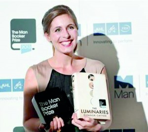 New Zealand writer Eleanor Catton, winner of the Man Booker Prize 2013, poses for photographs at the Guildhall in central London (Reuters)