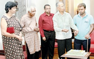 Pictures show (above) Sam Wijesinha cutting the anniversary cake. To his right are PCCSL CEO Sukumar Rockwood, and DRC members Devanesan Nessiah and Ms. Gnana Moonesinghe and (below right) PCCSL Chairman Kumar Nadesan presenting a memento to Mr. Wijesinha on behalf of the Commission. To his right are DRC members Daya Lankapura (partly hidden), Dion Schoorman, Siri Ranasinghe (President of The Editors' Guild and Editor in chief of the Lankadeepa), Lucille Wijewardene and Pramod de Silva former Editor of the Daily News. Pix by Indika Handuwala