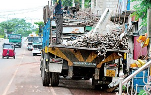 Lorries unloading goods blocking both motorists and pedestrians