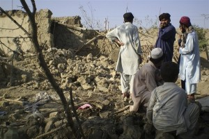 Tribesmen gather at a site of a missile attack on the outskirts of Miranshah, near the Afghan border. Reuters file pic