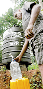 Villagers complain that the water supplied from these tanks do not even last a day. Pix by  Indika Handuwala
