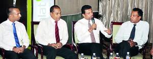 The three speakers with  STBC  president Chaturanga Perera