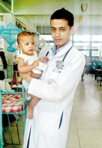 Chamara with a tiny patient during his  clinicals in the  Paediatric Ward,  Peradeniya Hospital