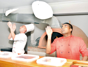 Chef Capodiferro and assistant demonstrate their pizza-making skills and below Antonio Ciocia. Pix by Ranjith Perera