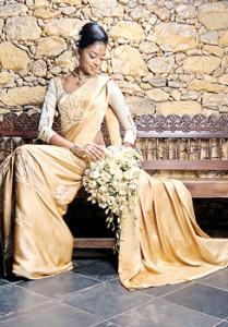 Ahinsa Lokudadella in a cream and gold Kandyan saree