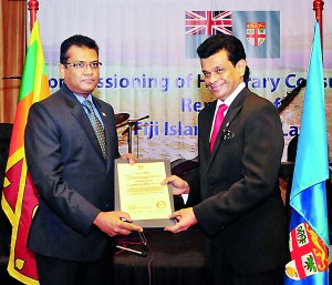 Picture  shows Parakrama Dissanayake, receiving the  appointment from Yogesh J. Karan.