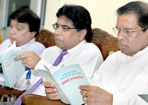 Health Minister Maithripala Sirisena, Health Ministry Secretary Dr. Nihal Jayathilaka and Colombo North Teaching Hospital Director Dr. Roy Perera perusing the booklet on Stroke Facts