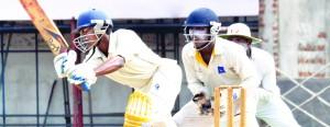 Bandaranayake College's Dhananjaya Vithana drives vs Ananda   - Pic by Ranjith Perera