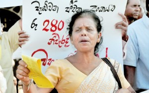 A protest in front of the Fort Railway Station on Thursday against rising cost of living. Pix by Mangala Weerasekera