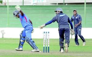 HNB batsman Ranil Dhammika is brilliantly stumped by John Keells wicket keeper Denuwan Rajakaruna - Pic by Amila Gamage