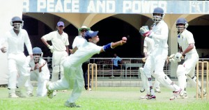 A St. Joseph's fielder narrowly misses an early opportunity to get hold of a catch of Chathuranga Rajapakse, who top scored for Maris Stella in their first inning. - Pix by Amila Gamage