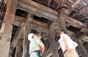 A close look: The Japanese team scrutinising Embekke's famous carvings.  Pix by Nilan Maligaspe