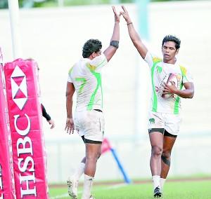 Sri Lanka skipper Fazil Marija (R) shares a high-five with team-mate Sandun Herath after beating Philippines - Pic SLRFU
