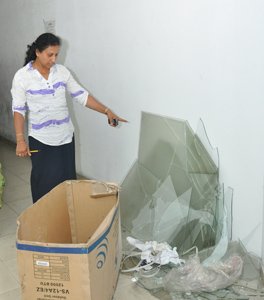 The contractor's wife points to some of the damage caused. Pix by Susantha Liyanawatte