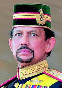 Brunei's Sultan Hassanal Bolkiah stands during his 64th birthday celebrations in Bandar Seri Begawan