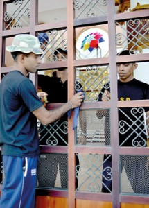 Last minute touches: Soldiers  polishing the main entrance of Nelum Pokuna on Friday. Pic by Hasitha Kulasekera