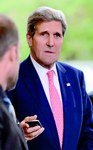 US Secretary of State John Kerry looks on upon arrival in Geneva on November 8, 2013 on the second day of talks with Iran on the country's nuclear programme. AFP