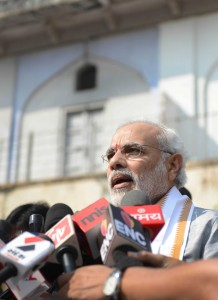 Gujarat Chief Minister and Bharatiya Janata Party (BJP) prime ministerial candidate Narendra Modi (C) speaks to the media. AFP
