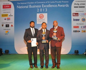 Picture shows Gemunu Goonawardena, Vice President - Resource Planning and Development / F&B, Aitken Spence Hotels (R) , Tilak Gunawardana, Vice President - Finance, Aitken Spence Hotels ( C) and Lakshitha Bandara, Financial Accountant, Aitken Spence Hotels (L)  along with the awards received at the ceremony.