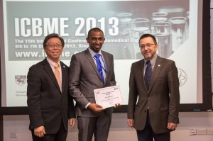 Angelo Karunaratne  (centre) wins the Young Investigator Award at the International conference of Biomedical Engineering