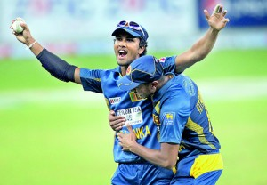 Sri Lanka's Dinesh Chandimal celebrates after taking a catch to dismiss Pakistan's Sohaib Maqsood during their second Twenty20 international cricket match in Dubai