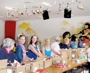 Much thought behind them: Volunteers take on the task of packing Christmas hampers