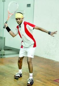 Navin Samarasinghe steadies himself for a rasping forehand. - Pic by Ranjith Perera