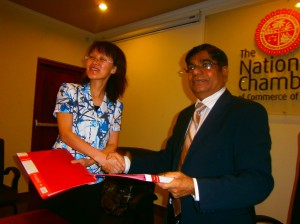 Ms. Wu Lixia, Vice Chairman, CCPIT, Gansu is seen exchanging the signed MOU with Thilak Godamanna, Senior Deputy President –NCCSL.