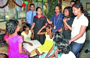 Nilantha Bastian, Head of Retail Banking & Wealth Management with staff volunteers at the Sri Sangamiththa Balika Niwasaya in Kohuwela copy