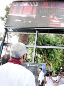 Speaker Chamal Rajapaksa looks up at the giant screen at Parliament grounds on October 23, the first day on which House proceedings were telecast live
