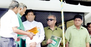 UNP General Secretary Tissa Attanayake hands over appointment letters to Ravi Karunanayake and Mangala Samaraweera, who are members of the party's newly appointed Leadership Council, as Sajith Premadasa who has not accepted his nomination to the council looks on. Pix by Susantha Liyanawatte