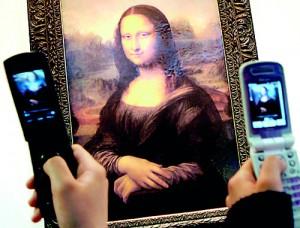 A crowd gathers around Leonardo Da Vinci's Mona Lisa at the Louvre (AFP)