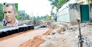 Athula Dias (inset): His parapet wall (above) was taken down and some five perches of his land taken without any official valuation of the property