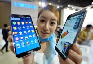 A model holds Samsung's first 'curved' smartphone Galaxy Round (AFP)