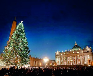 """The giant Christmas tree in St. Peter's Square was illuminated on Friday, December 13, and Pope Francis told visiting German  pilgrims that the tree symbolizes """"the joy of the brilliant divine light."""" (Reuters)"""