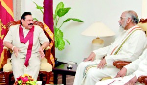 Building up a working relationship: Rajapaksa and C.V. Wigneswaran exchanging views soon after the latter took oaths as the Chief Minister of the Northern Province.