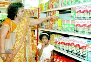 Champa de Silva: A search for full cream milk powder led her a few packets of Maliban milk at the Sathosa.  Pix by Indika Handuwela and Athula Devapriya