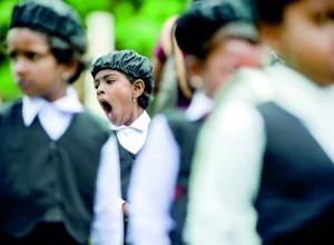 A long day: A child struggles with boredom at a school event in the North