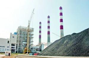 Coal is piled up near the Lakvijaya power station, waiting to be crushed and burned. Pix by Nilan Maligaspe