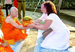 Accepting alms after being ordained.  Pix by Athula Bandara