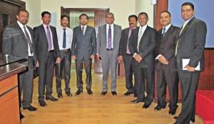 Commercial Bank representatives with Al Ahalia management.