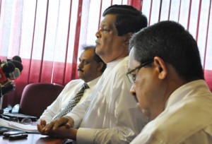 Education Minister Bandula Gunewardene, at the centre of a controversy over remarks he made about the Year Five Scholarship Exam explains his position at a news conference last week. Examination Commissioner W.M.N.J. Pushpakumara (left) is also in the picture. Pic by Susantha Liyanawatta