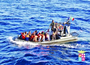 Immigrants being rescued by the Italian Navy near the Italian island of Lampedusa on Thursday. Italy's navy has rescued 233 mostly African immigrants from a boat in trouble off the coast of the Mediterranean island of Lampedusa, the scene of two shipwreck tragedies last year. AFP
