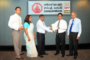 Picture shows Tuli Cooray, JAAF Secretary General exchanging documents with Aravinda Perera, Managing Director - Sampath Bank. Also in the picture are Jumar Preena CEO of CH17, Ms. Yasmin Rohana Juhari, Chairperson of Channel  17 and Ranjith Samaranayake, Group Chief Financial Officer of Sampath Bank