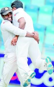 Sri Lanka captain Angelo Mathews and bowler Rangana Herath celebrates