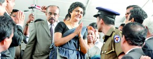 Chief Justice 43 Shirani Bandaranayake clad in a black saree greets her well-wishers in Hulftsdorp before she leaves for the parliament complex to appear before the PSC. File photo.
