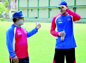 Nepal coach Pubudu Dasanayake discusses a point with his skipper Paras Kadhka